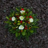 Seasonal grave posy with artificial Christmas roses