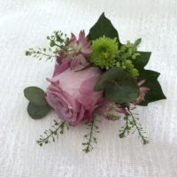 Lilac rose boutonniere