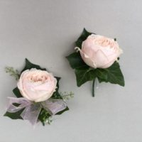 Pink rose ladies and gents buttonholes