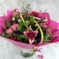 Pink tied wrapped bouquet