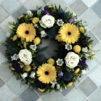 Yellow purple and white wreath